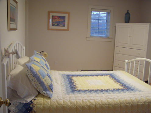 Queen bedroom with attached bathroom on 1st floor